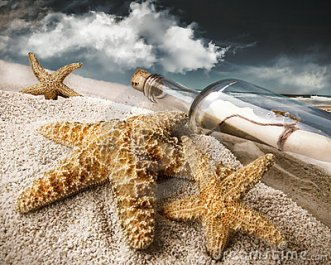 message-bottle-buried-sand-14537957