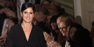 Italian designers Maria Grazia Chiuri and Pier Paolo Picciolo acknowledge the public at the end of the Fall/Winter 2011-2012 Haute Couture Collection Show for Valentino on July 6, 2011 in Paris. AFP PHOTO/PIERRE VERDY (Photo credit should read PIERRE VERDY/AFP/Getty Images)