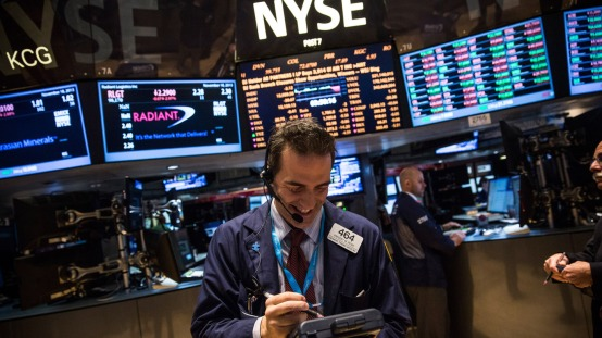 For the first time in its history, the Dow Jones industrial average closed above 16,000 points Thursday. The index of 30 stocks touched the mark earlier this week, when a trader was photographed at the New York Stock Exchange.