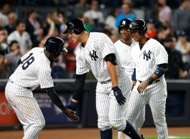May 2, 2017; Bronx, NY, USA; New York Yankees shortstop Didi Gregorius (18) and right fielder Aaron Judge (99) celebrate in the seventh inning after scoring against the Toronto Blue Jays at Yankee Stadium. Mandatory Credit: Noah K. Murray-USA TODAY Sports